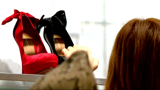 Evolution of shoe design as footwear sales hit record levels ENGLAND London Various shots stiletto shoes highheeled shoes TILT UP Red patent leather...