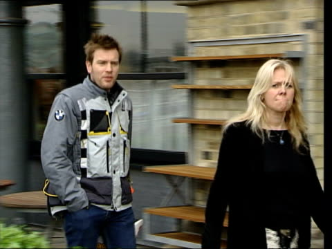 ewan mcgregor round the world motorbike trip screen on motorbike zoom in i/c next motorbike mcgregor along with woman pan mcgregor posing with... - name tag stock videos and b-roll footage