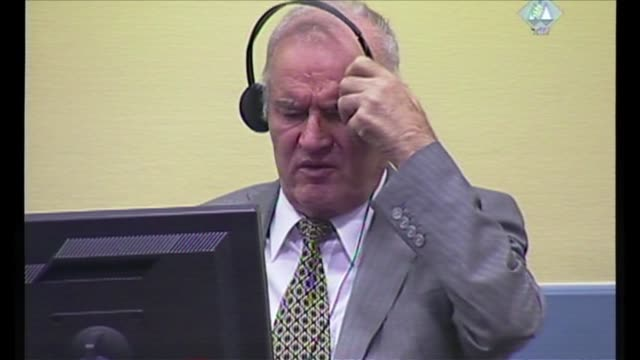 ex bosnian serb military chief ratko mladic on monday refused to enter a plea before a un war crimes court shortly before a judge ordered his removal... - ratko mladic stock videos & royalty-free footage