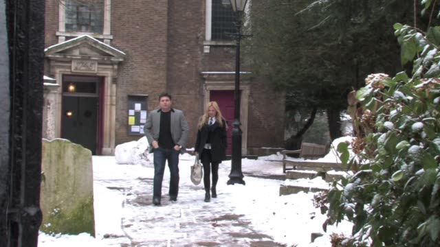 ex spice girl geri halliwell and george michael's expartner kenny goss visit a north london church for 45 minutes before travelling together to a... - geri horner stock videos & royalty-free footage