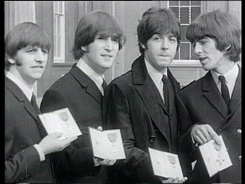 october; lib buckingham palace: the beatles posing with mbe awards - the beatles stock videos & royalty-free footage