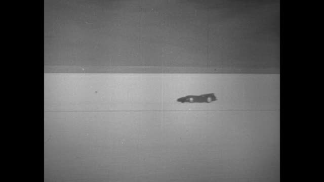 [9/1/35 exact date not known utah] tracking shot car bluebird streaks along the bonneville salt flats in driver sir malcolm campbell's attempt to set... - bonneville salt flats stock videos and b-roll footage