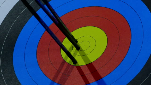 exact hit of arrows from the bow in the center of the target - arrow bow and arrow stock videos & royalty-free footage