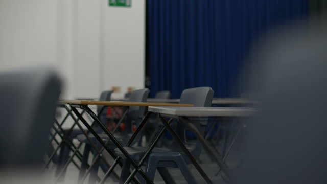 exam hall empty desks - educational exam stock videos & royalty-free footage