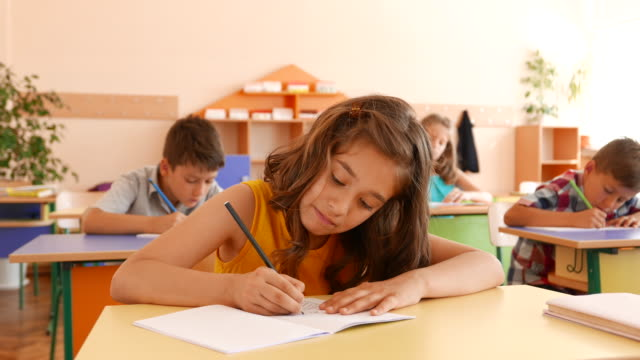exam in classroom - primary school child stock videos & royalty-free footage