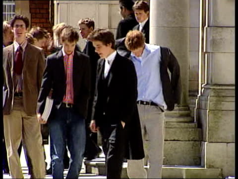 stockvideo's en b-roll-footage met exam shake-up proposals; lib eton college: ext prince harry along in blazer and chinos from school - blazer