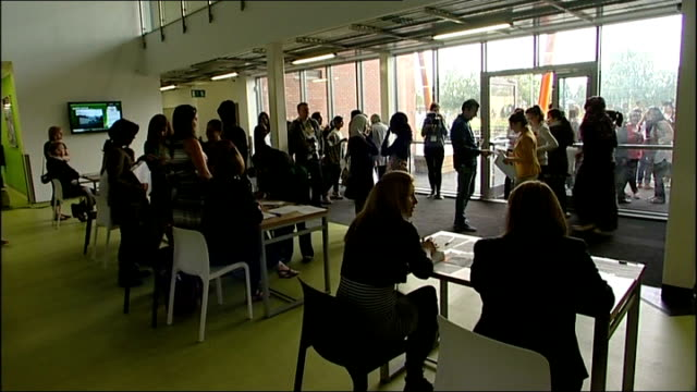 government accused after fall in pass rate manchester levenshulme high school girls opening gcse results envelope teachers chatting students in... - 女性教師点の映像素材/bロール