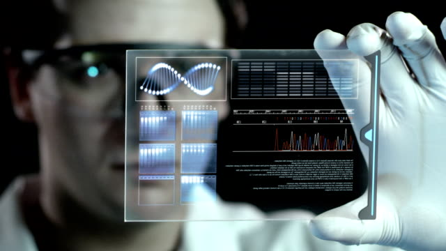 stockvideo's en b-roll-footage met examining the dna. - futuristisch