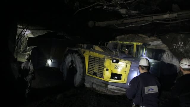 excavated copper ore is offloaded into a cart at the taymyrsky copper mine operated by mmc norilsk nickel pjsc in norilsk russia on wednesday oct 18... - moneta da 5 centesimi statunitensi video stock e b–roll