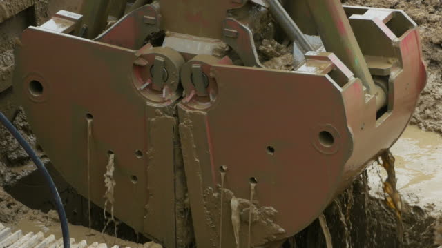 excavator and pile driver machine drilling rigs - pile driver stock videos and b-roll footage
