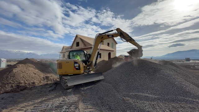 excavator at suburban construction site in lehi, utah, u.s., on wednesday, december 16, 2020. - lehi stock videos & royalty-free footage