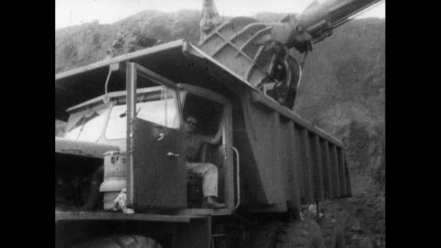 ws excavator bucket dropping earth into dumper truck; 1964 - quarry stock videos & royalty-free footage