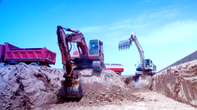 excavator construction - construction vehicle stock videos & royalty-free footage