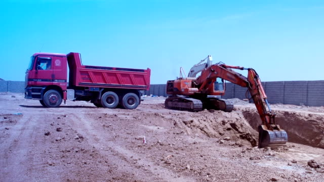 excavator construction - dump truck stock videos and b-roll footage