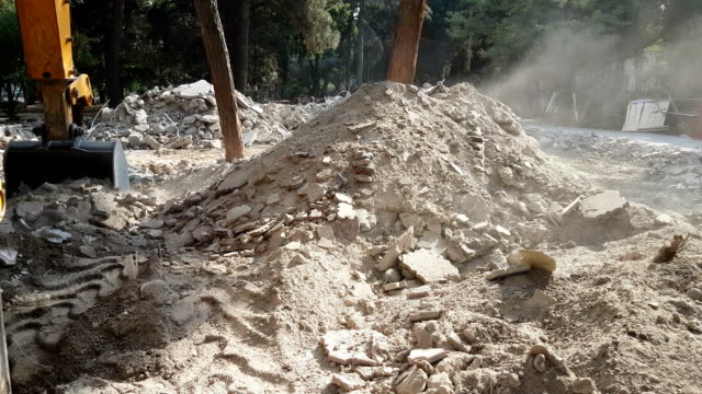 excavator demolishing some construction - bulldozer stock videos and b-roll footage