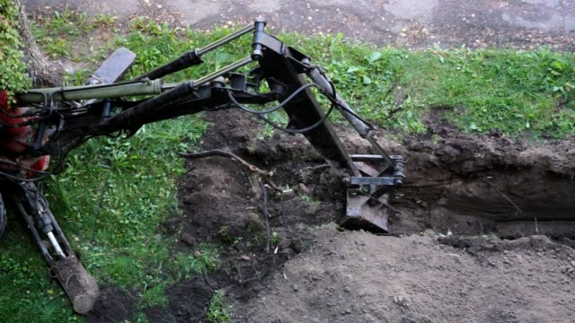 excavator digging a trench. - trench stock videos and b-roll footage