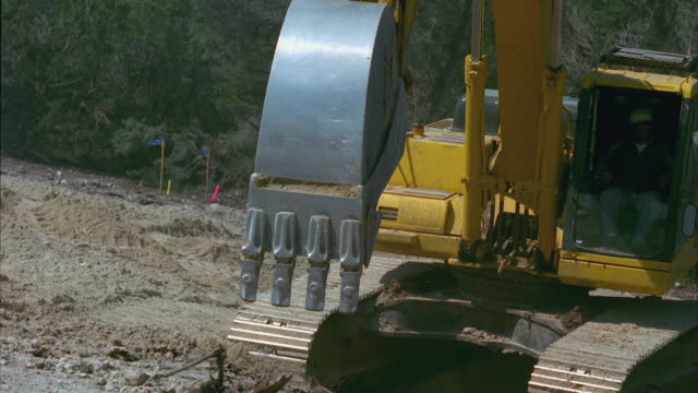 ms pan tu slo mo excavator digging up rubble at construction site / cedar park, texas, usa - cedar park texas stock videos & royalty-free footage