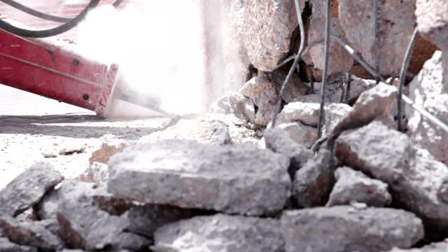 excavator hydraulic jackhammer breaks concrete - rebuilding stock videos and b-roll footage