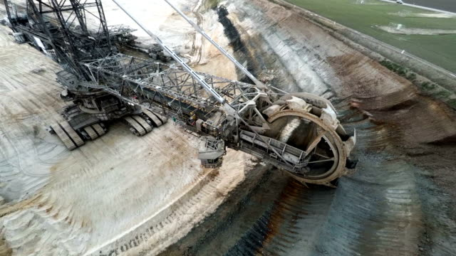excavator in brown coal surface mine - mining natural resources stock videos and b-roll footage