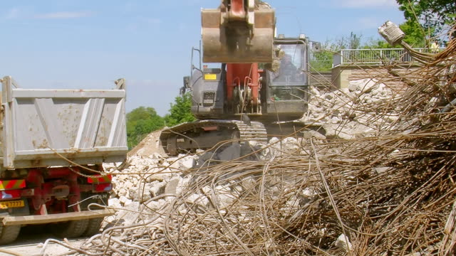 ms excavator loading material in dumper at deconstruction of bridge over river mosel / wellen, rhineland palatinate, germany - dump truck stock videos and b-roll footage