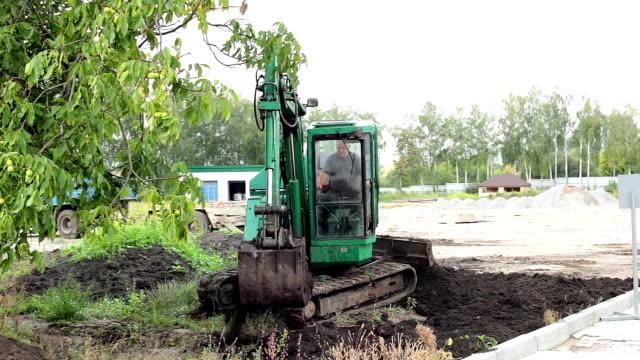 Excavator moves the ground.
