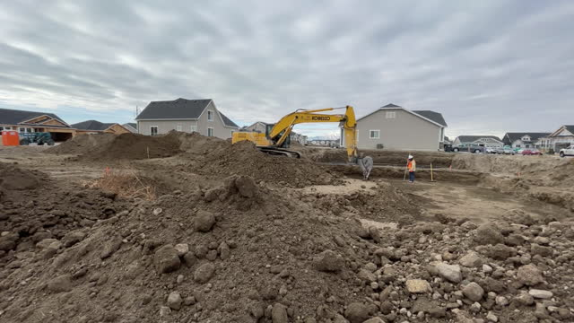 excavator moving dirt at suburban construction site in lehi, utah, u.s., on wednesday, december 16, 2020. - lehi stock videos & royalty-free footage
