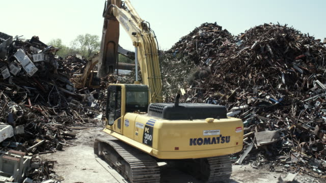 ms excavator moving junk scrap metal to pile, dallas, texas, usa - scrap yard stock videos & royalty-free footage