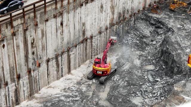 excavator on construction site. - spoonfilm stock-videos und b-roll-filmmaterial