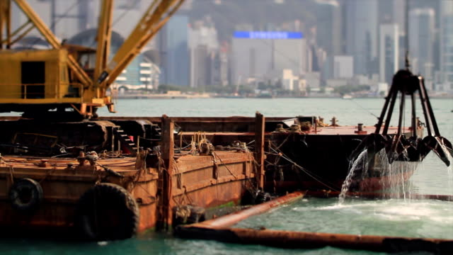 Excavator on the Barge in Hong Kong at Work