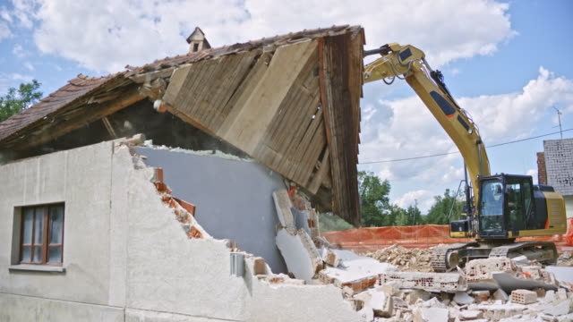 excavator pushing the roof off an old building and destroying it - only mature men stock videos & royalty-free footage