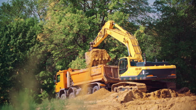 excavator - dump truck stock videos and b-roll footage