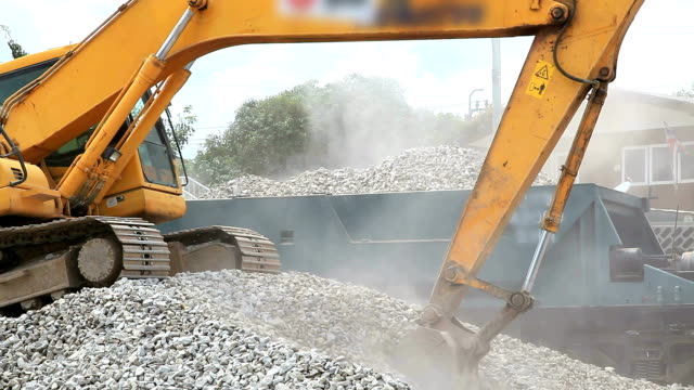 Excavator working and loading