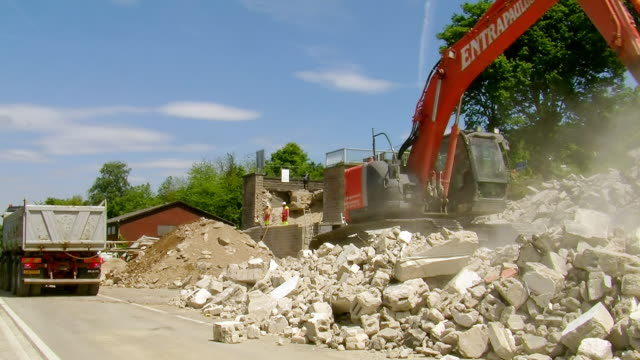 ws excavator working at deconstruction of bridge over river mosel / wellen, rhineland palatinate, germany - dump truck stock videos and b-roll footage