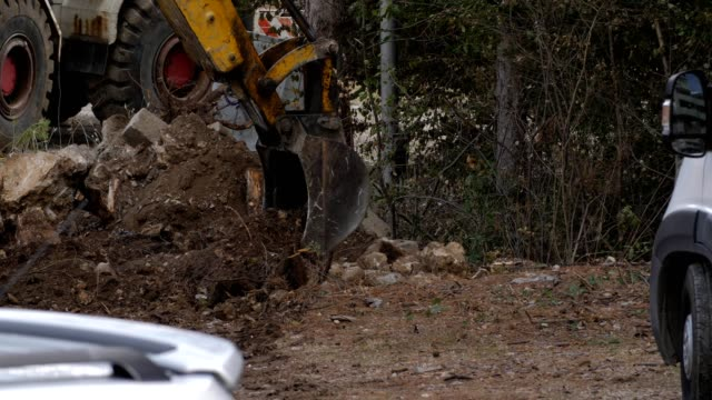 excavator working on a construction site. - hydraulics stock videos and b-roll footage