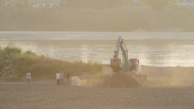 WS excavator working on bank of Mekong River / Vientiane, Laos