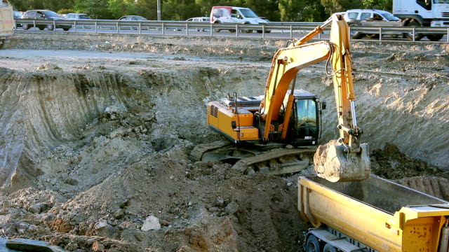 Excavator working on road