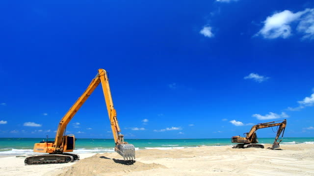 excavator working on the beach - excavator stock videos and b-roll footage