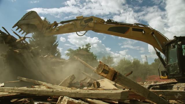 cs excavator working on the site of a building demolition - earth mover stock videos & royalty-free footage