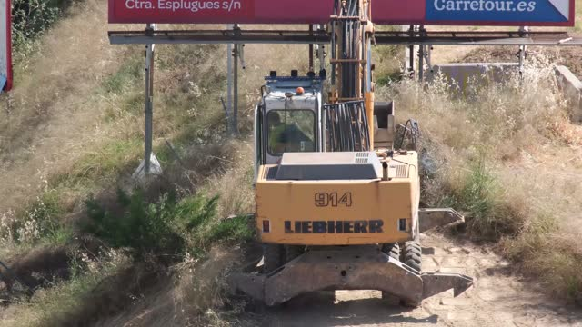"""excavators are heavy construction equipment consisting of a boom, dipper (or stick), bucket and cab on a rotating platform known as the """"house"""".the house sits atop an undercarriage with tracks or wheels. they are a natural progression from the steam - mechanical digger stock videos & royalty-free footage"""