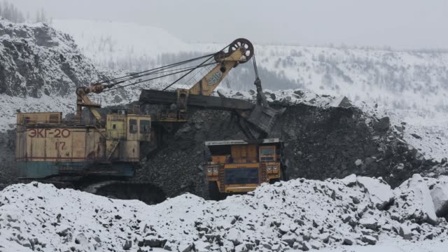 excavators arrange waste material from coal excavations at the krasnogorsky open pit coal mine operated by oao mechel mining, a unit of oao mechel,... - mining stock videos & royalty-free footage