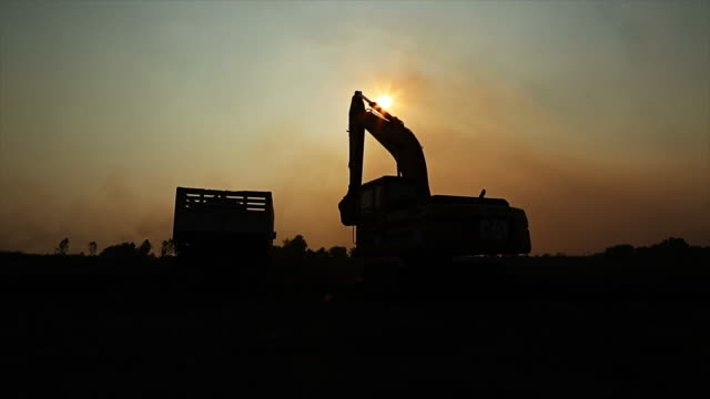 excavators machine in construction site and silhouette backhoe - hydraulic platform stock videos & royalty-free footage