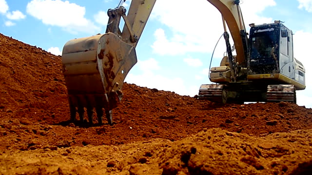 excavators machine in construction site on sky background - bulldozer stock videos and b-roll footage