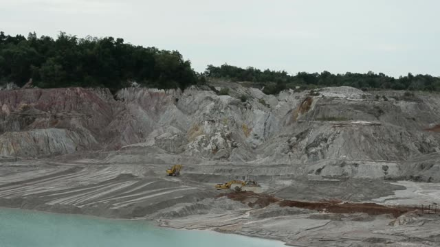 excavators strip the overburden to reach tin ore in the mine pit at the pt timah operations in sungai liat, bangka island, indonesia, on tuesday,... - tin mine stock videos & royalty-free footage