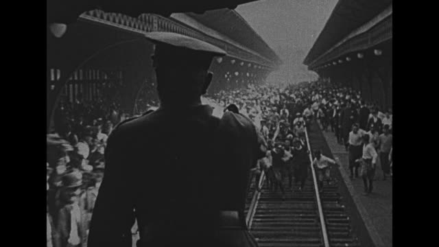 excellent footage of crowds clustered around train tracks seen from behind gen john pershing standing at the rear of the moving train acknowledging... - 1910 1919 stock videos and b-roll footage