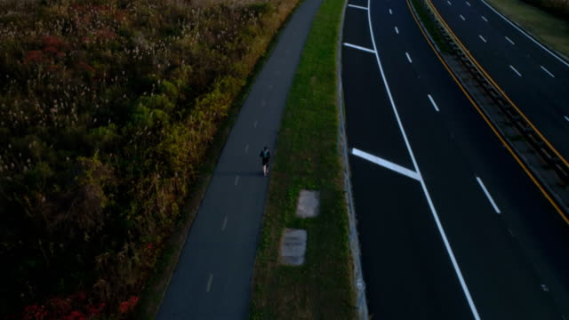 excercise on jones beach, wantagh state parkway bike path aerial view - long island video stock e b–roll