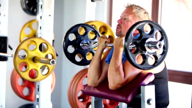 excercising gym health club fitness caucasian male - arm curl stock videos & royalty-free footage