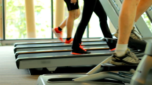 excercising treadmill running gym health club fitness - exercise equipment stock videos and b-roll footage