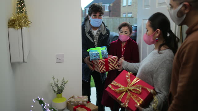 exchanging gifts with parents - guest stock videos & royalty-free footage