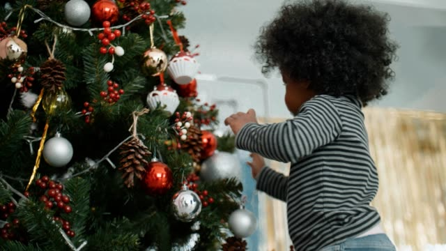 excited african cute little girl celebrate christmas at home - 2 3 years stock videos & royalty-free footage