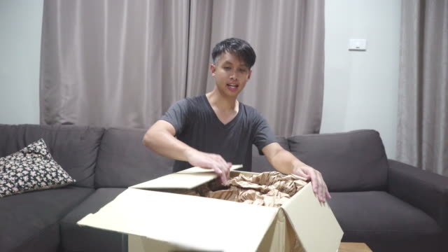 excited asian unboxing household equipment from shopping online - household equipment stock videos & royalty-free footage
